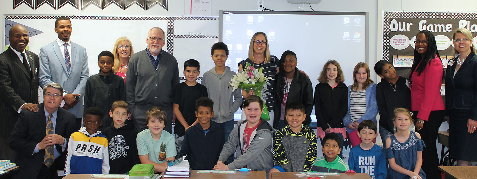 Teacher of the Year, Mrs. Tkacik, with students and administrators