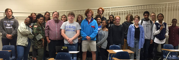 Jay Whitacre, a personal finance teacher at E. C. Glass, with his class