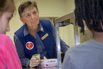 Vice Mayor Mary Jane Dolan serving students lunches