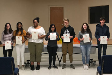 Students holding German Honor Society certificates