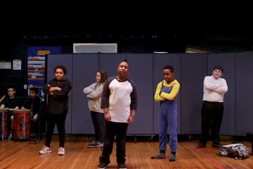 Five elementary students performing rap routine