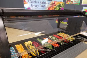 New food bar stocked with fruits and vegetables