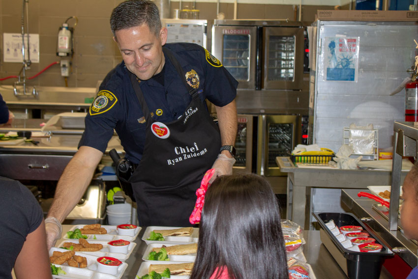 Police Chief Zuidema serving students lunch