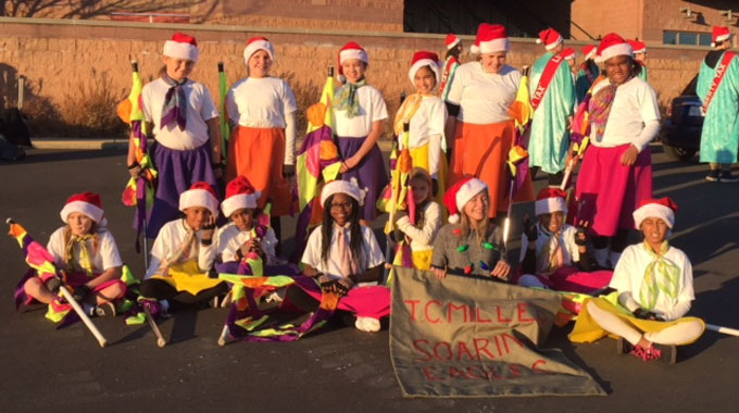 TCM flag and dance corps at start of holiday parade