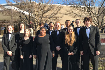 Honor band students standing outside in concert attire