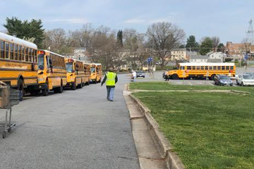 Buses lined up to deliver meals