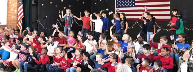 3rd grade play waving flags