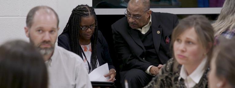 Dr. Edwards speaking with community member