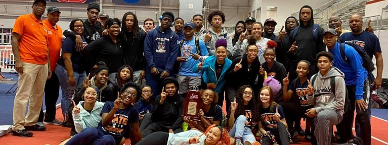 Indoor track team with trophy