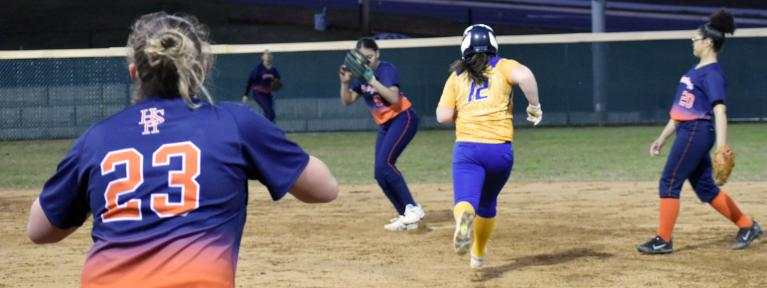 Softball infielder stepping on base