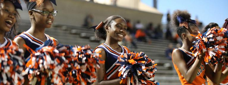 Cheerleader smiling at camera