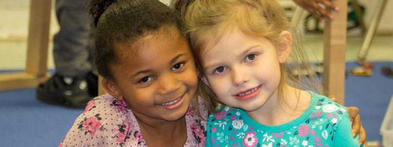 Two pre-k girls smiling
