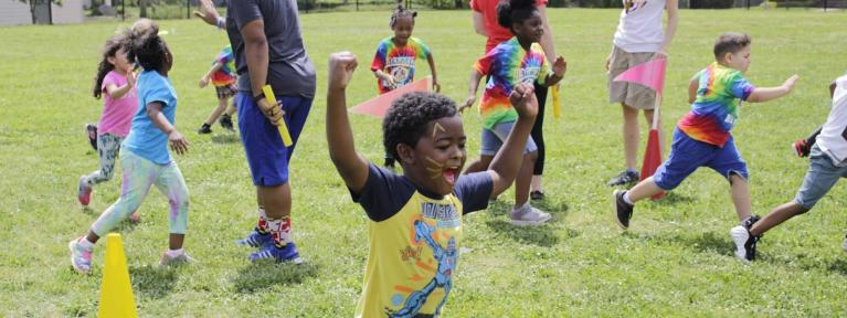 Boy running outside during field day